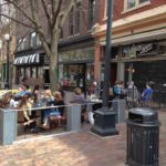 Outdoor seating for restaurant named Graze on Pedmall in downtown Iowa City